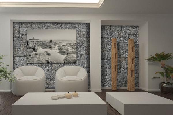 Bequeme Lobby mit Weiße Sofas und Statuen aus Holz und Wände aus Graue Deko Steine.