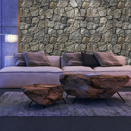 Savoie Grey mit seiner wilden, unregelmäßigen Textur in einem modernen Wohnzimmer mit Fliesenstämmen und einem großen bequemen Sofa.